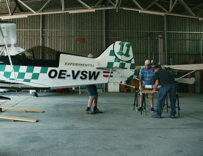 Hangar, Building, Person